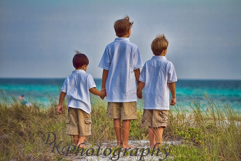 "07-09-2011<br /> ""Brotherly Love""<br /> <br /> These are the boys of friends of ours who were also in Florida while we were.  I took many photos of the family and have been editing to show options of processing.  I liked this one after I played in Topaz Adjust.  I hope they like what I've done with some of the shots.<br /> <br /> Comments are always appreciated.<br /> Donna"