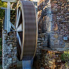 """10-23-2012<br /> """"Waters Flow, Gently Flow""""<br /> <br /> Yesterday I took photos of a couple who are good friends of ours.  We took them at Wright's Mill, a subdivision in my area.  This water wheel is at the entrance.  I have posted photos from this spot before.  After we were finished I decided to take a very slow shutter speed photo of the wheel.  I didn't have my tripod so this is hand held.  I thought it turned out pretty cool.<br /> <br /> I've always heard retirement is just so busy.....well I'm proof of that.  John and Cline Tours (our business) is being featured in a national magazine, Busline.  Instead of hiring a professional photographer he insisted I take the photos  for the magazine.  I have been so stressed.  After I submitted them to the magazine, they told me they were exactly what they needed.  I can't wait until it comes out.  I can't believe this serious hobbyist is actually going to be published!!!! Pretty excited.  Now John needs to pay me photography fees.  I have to admit he is always bragging on my photography.  It's a happy day!<br /> Thanks for the comments on our photo.  From the comments I will tell you, we are very happy together and have been that way for 22 years.<br /> Critiques and comments always welcome.<br /> Donna"""