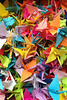 A Sedge of Cranes<br /> <br /> (May 22, 2013) The owner of Mr. T's, where we go for breakfast on the weekends, passes the time making small origami cranes. This is a cell phone photo of her box of work.