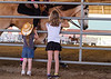 Princess fans<br /> <br /> (May 3, 2013) These two girls were so excited to see the rodeo princesses that they had just met out there riding in the arena and waving . . . at them! Starting on the Extreme Bull Riding photos now, but tonight is the Riverside Show and Go, so don't know when I'll get back to finishing them up.
