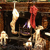 "12-19-2010<br /> ""Stockings Were Hung""<br /> <br /> These stockings belong to Tucker, Sutton and Hughes.  They are hanging in my living room where the Christmas tree and most of  the decorations are.  Yes I have many more Santas than those posted up to this point.  I also really like this fireplace.  When we built our house I wanted this room to be very special!  I'm sure some of you are not fans of my decor but I love it even if it's not the norm.  LOL  There will be so much in these stockings that they will not be hanging but on the floor in front of the fireplace.  Can you say,,""Spoil the Grandchildren?""  <br /> <br /> Thanks for the comments on ""Lollipop"" and my other photos.  I'm having a blast.  What other time of the year do we have so many options.  Hopefully I can take some that are not in my house.  <br /> <br /> Have a fantastic week.<br /> Donna"