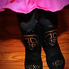 "12-29-2010<br /> ""Twinkle Toes""<br /> <br /> Sutton got ""Twinkle Toes"" boots for Christmas.  For those of you not familiar with the rage.....when they walk the toes light up.  She did some jumping for me today so we could get them lit.  You can see a few of the stones are lit.  When they are in the dark they are really bright.  She also has tennis shoes that do the same.  She does like to make a fashion statement.<br /> <br /> Thanks for the birthday wishes.  I am looking forward to dinner out with friends tonight even though it's the day after.  <br /> I thought some of you would like the car from yesterday.  It did bring back memories.  If I don't get much commenting done tonight I'll try to catch up tomorrow.<br /> Donna"