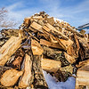 Shrinking wood pile