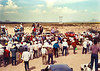 """A Day at the Races<br /> <br /> (November 26, 2018) I was going through some old photos and came across this one from 1989 in Mexico. It was a day of Quarter Horse races a little north of Ceballos, Durango, close to the border with Chihuahua. If you look on the right, you can see both horses entering the frame (and the crowd). The """"rail"""" was some rope strung between poles."""