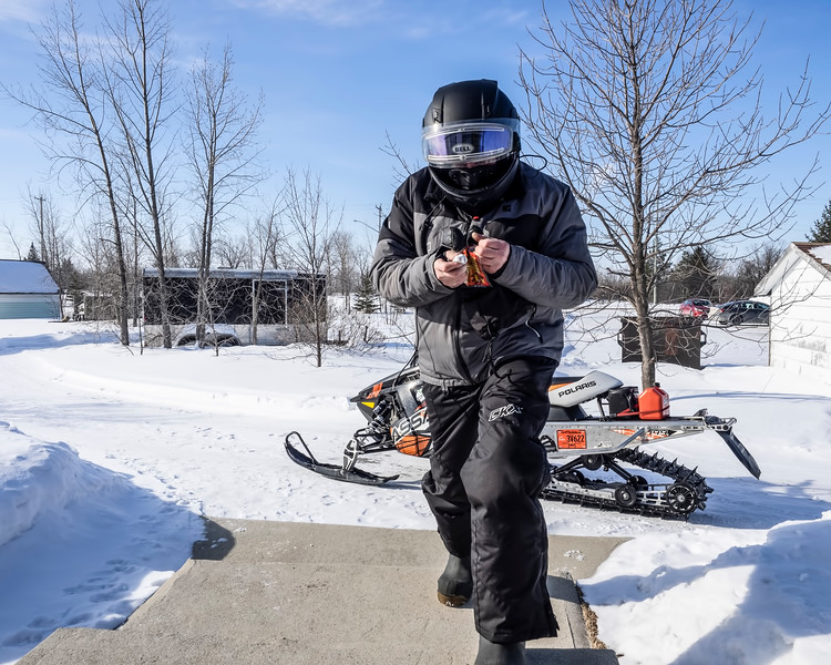 You just never know when an alien will come calling… :-)  (Hubby heading out for a ride on the snowmobile, looking for his mitts…. ) 03/18/19
