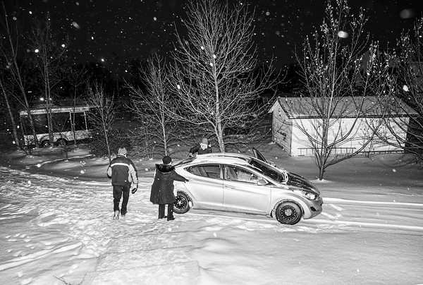 Brushing snow off the car