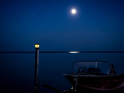 Full moon over the water (by Janet)