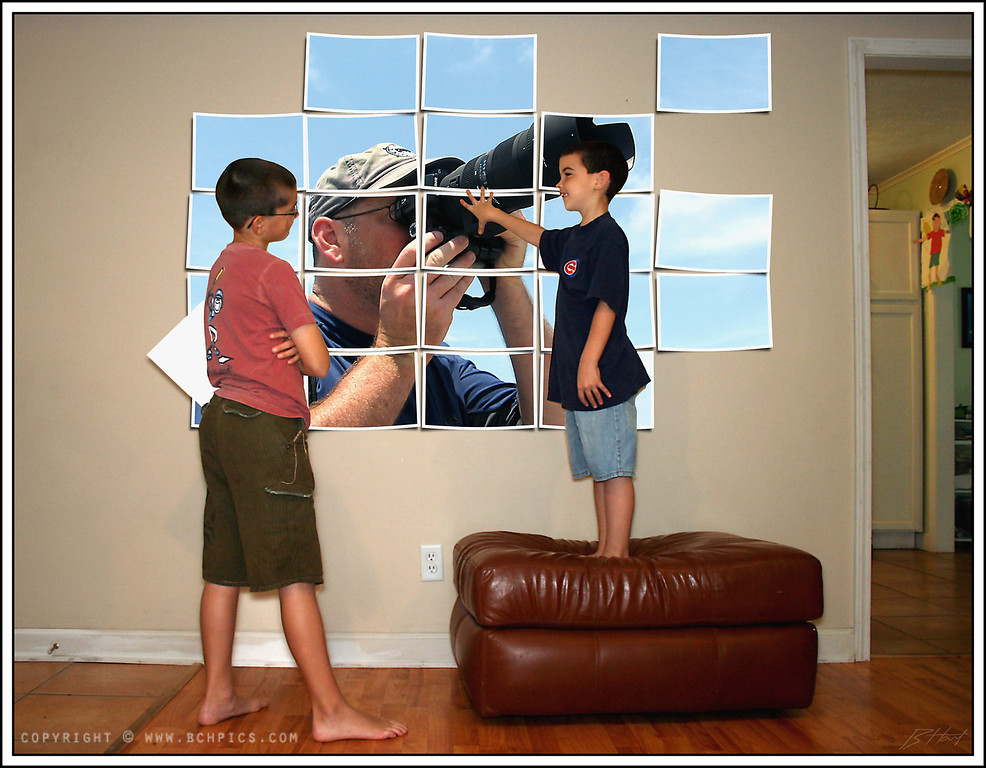 August 16, 2008<br /> <br /> Just me and the boys again today...thought we'd do some redecorating.  The boys think there should be a larger-than-life-size picture of one of us on every wall we have... <br /> <br /> The pic they're hanging was one Trev took of me last July (He's quite the artist)...We found it today...thought his entire memory card had been lost...  And, if you look in the upper right, there's some more of Trev's artwork...<br /> <br /> <br /> Post:<br /> ...OK, so we didn't really hang it (probably wouldn't have gotten away with it anyway)... The boys are standing in front of a blank wall... I created the collage effect using a free action from Panos FX... (use your favorite search engine that rhymes with oogle...)...and then merged it in between the boys and the wall...I had them hold blank sheets of paper to help them look more like they were really doing it...actors they're not, but it turned out ok... they like it. :)<br />