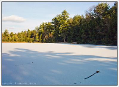 November 28, 2008  I suppose skipping rocks is not a winter sport...  Frozen Pond at Hickory Run SP, PA
