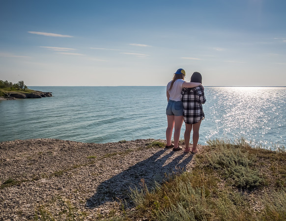 Hot summer days, long summer evenings....  Mackenzie & her best friend take a moment to enjoy the view, looking out over Lake Manitoba. And yes, it really is that beautiful aqua colour. 02 06 15