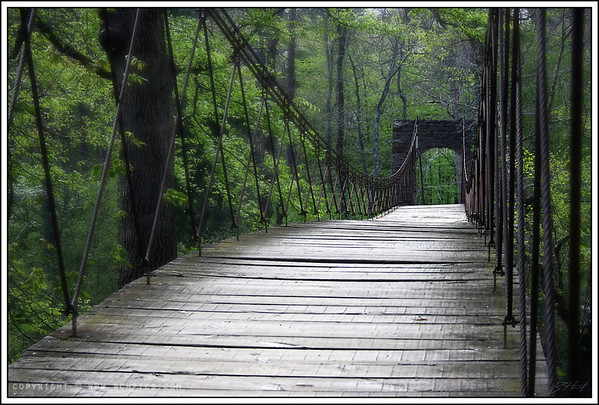 April 25, 2008  Swinging Bridge at Tishomingo, Built in 1939 -   I shot this same bridge about a year ago, and have always liked the pic, but was never really satisfied with it...I'm happier now-  edit: the other shot. &nbsp