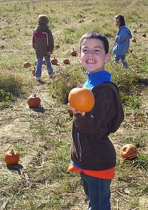 October 29, 2008  Proud of his pumpkin...