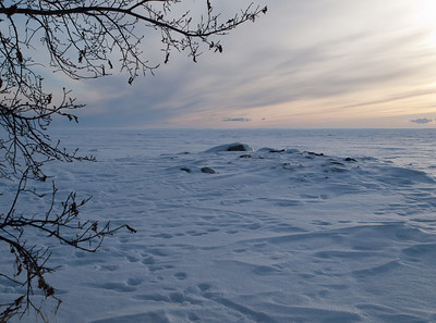 As the sun sets, looking across the frozen expanse of Lake Manitoba. 03.03.12.