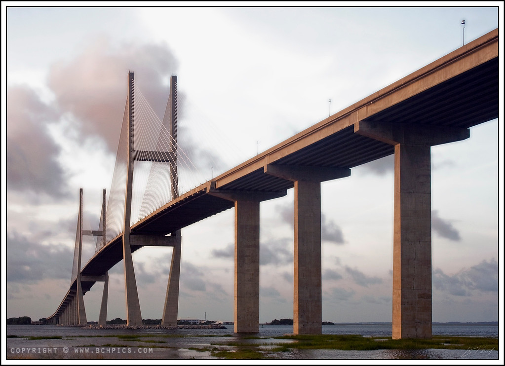 August 1, 2008<br /> <br /> Finally processing the last of my costal GA pics...been a busy few months...  This is the Sidney Lanier Bridge just outside of Brunswick, lit by the sun setting off to the left-<br /> <br /> Post:<br /> ...lost track on this one, but the there were some shadow/highlight adjustments and a diffuse glow filter on the sky-<br /> <br />