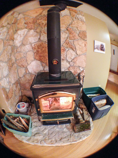 Fisheye view of our woodstove....<br /> <br /> One of the add-on lenses I was given for my iPhone - plus a wide angle, a macro and a telephoto. They are lots of fun to play with, just wish I could get outside and really put them through their paces.<br /> 01.27.15