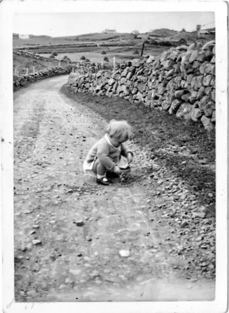 Playing with all my friends... somewhere in England or maybe Scotland...  I think I must have been a stray & my parents found me by the side of the road, cause this is the earliest shot I can find of myself amoungst our small supply of childhood photos. Perhaps this was taken around the time that cameras were invented...:-))   Didn't really do any restoring on this very, very, very old print (it's almost as old as I am, oddly enough!), just thought I'd leave the old, tired, almost worn out look just as it is...  Anyway... this is my entry in Colleen's challenge. I thought it was tomorrow & was going to post then, but just noticed that many folks put up 2 shots today, so I guess I will do the same.   I've been thoroughly enjoying all the other 'early childhood' shots... this is such a fun idea, Colleen... thanks!! 01.17.11