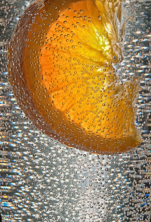 Oranges, soda water & sunshine.... create many, many bubbles.... :-))  Pushed my comfort zone with my attempt to throw a chunk of orange into a glass of bubbly water - I thought it would be a quick & easy shot for the Dailies... NOT! An hour & a half  & 396 shots later, I finally shut 'er down & cleaned up the mess. Out of all that, I think I got 4 usable images.... oh well, once again, I think I learned a lot...  Wow.. thank you all so very, very much for your comments on Mackenzie's pics! We appreciate every one ..... you are all so thoughtful, kind & encouraging! Hope you are enjoying a wonderful week...:-))  02.10.11