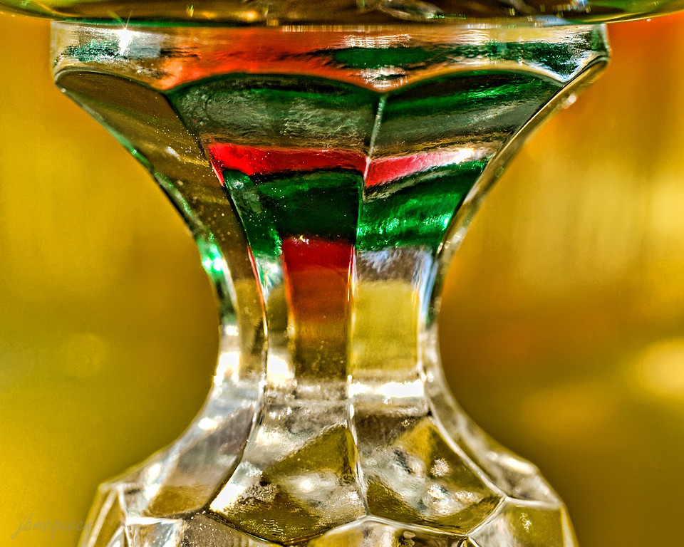 This wine glass with a colored poster behind it was good practice for my macro lens. Was thinking mostly of color and texture ....