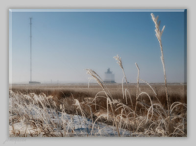 "Prairies grasses, grain elevator & cell phone tower on a foggy, frosty morning.  As you can tell, I'm having a wee bit o'trouble coming up with a catchy title... :-))  I could definitely use your help, Paula...!  I'm so glad you liked my pic of the train wheels yesterday.... you would not believe the weird position from which I shot that! I wanted to be as low as I could go but the idea of actually laying down so close to the tracks freaked me right out, so somehow - I was stil on both feet! Fortunately, there was not another soul for miles around... lol. 02.23.12  edit: Re-named... ""Triangles""..... thanks so much Billiejean, I love it!!"