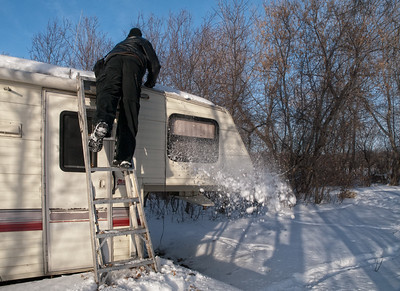 Due to the flooding last summer, we had to leave our camper at the lake for the winter. Last weekend we drove up to see how it's doing. As you can see, all is well ... just had to brush a little snow off the roof & make sure everything was ok up there.  I thought this shot might make a nice comparison image to all the latest shots of spring on the Dailies.... so many of you have lovely shots of flowers & buds about to burst. Welcome to spring in Manitoba! Don't you wish you were here?  Oh well, it's not that bad really.... I love the snow & don't mind the cold, it just gets a little tiresome when March rolls around & I begin to long for something green.... sigh .... won't be long now...  Happy Leap Year day!! Make it a good one! 02.29.12