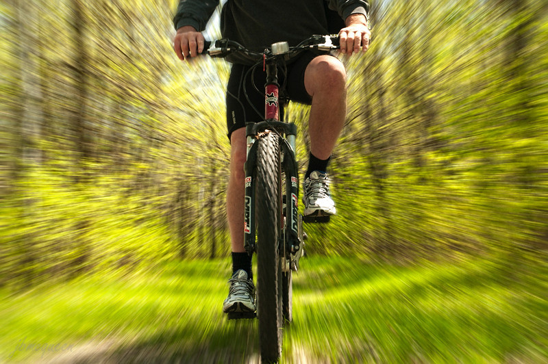 What happens when one lies in the middle of a bicycle path....  This is definitely not one of my attempts at panning.... I wish it was...! Just some playing around with the radial blur filter...:-)) 06.02.11