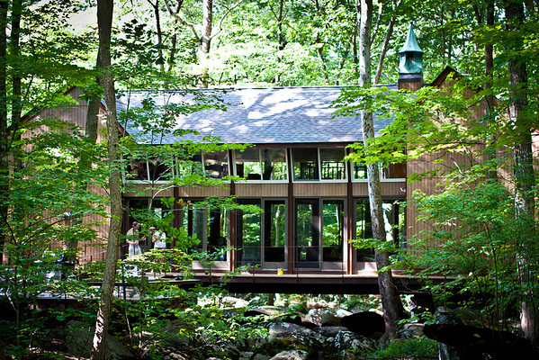 July 28, 2010 Paul's amazing house in the woods. I went over to help them paint their wrap around deck today.  We obviously didn't finish it, but when we ran out of energy I decided to go rock jumping down the stream to get a photo of the whole house.