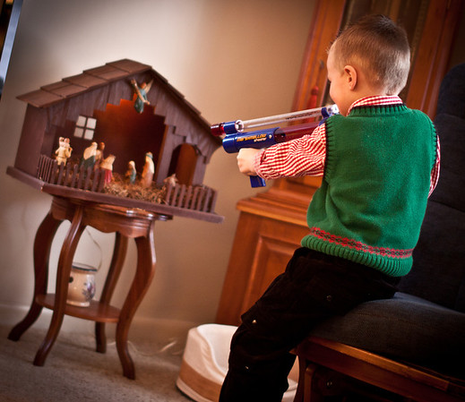 December 25, 2010 Marshmallow Shooters FTW. I'm not sure who told him to aim at the manger...  ;-)
