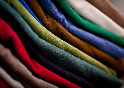 August 10, 2010 Yesterday I cleaned out my closet and threw away half of my t-shirts.  Today, I discovered that if I fold all of my shirts in half instead of thirds, that I could fit them on the shelves much better.  I also decided to sort them by solid colors verses shirts with printing on them.  This is a stack of solid colors.  My friend tells me that I have a little OCD in me...
