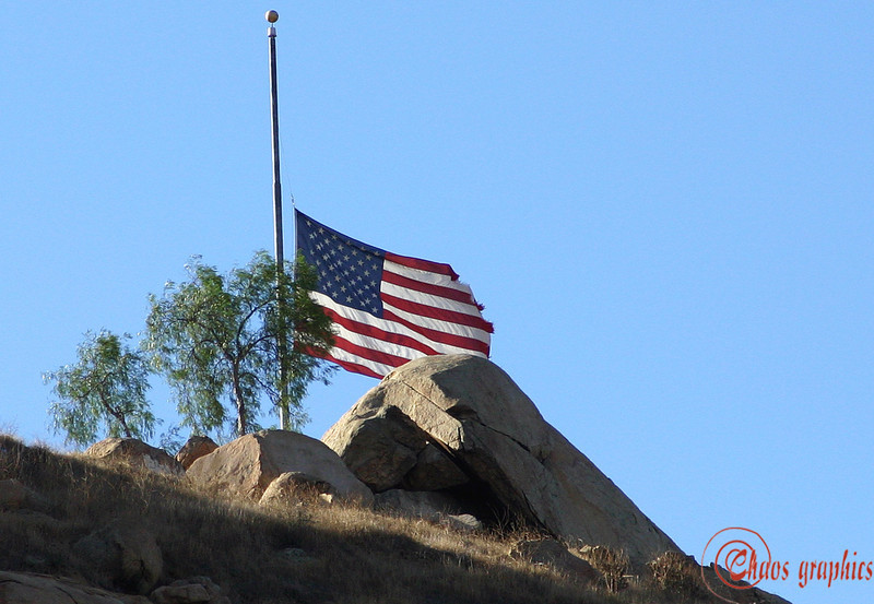 Half mast<br /> <br /> (oct. 28) Flags were flying at half mast today to honor the memory of the four firefighters killed and one critically injured in the Esperanza Fire in the San Jacinto mountains above Banning. This flag is already a little tattered. It flies atop Mount Rubidoux and is visible from much of downtown Riverside and Rubidoux.
