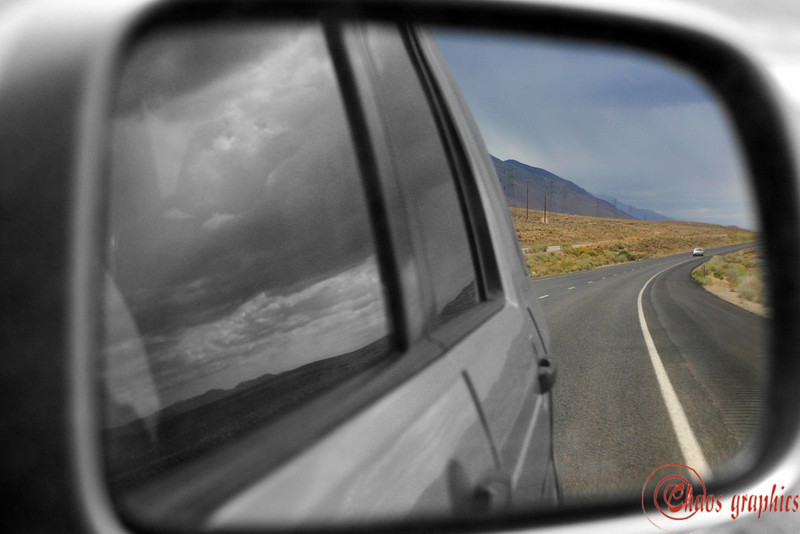 Rear View Mirror<br /> <br /> (Oct. 13) Headed up Highway 395 along the base of the eastern Sierra Nevada. This is pretty much what it looks like coming and going.