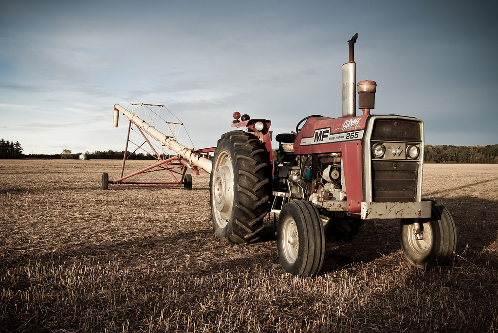 I captured a similar tractor a few years ago, this one is a more recent Massey Ferguson model but similar composition.