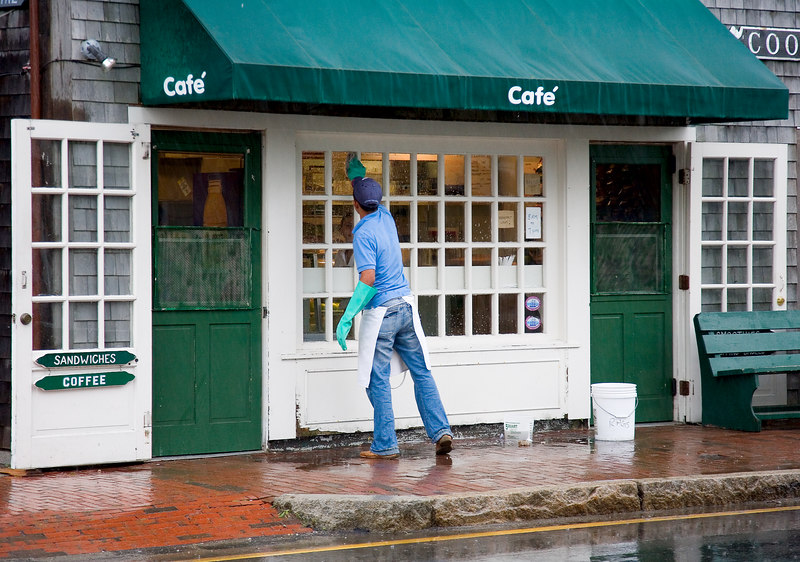 <h3>What's the Point?</h3> Window cleaning in a deluge on Nantucket.  24 June 2006