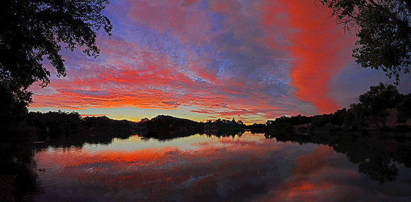 August 26  ****************WOW!!***************** This sunset show was VERY spectacular! To include as much of the colors both high in the sky, and then reflected on almost all of the water, this is my first attempt, using this configuration, at a 6 shot panorama! I DID add a slight bit of contrast after merging the images.