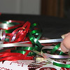 12/23/11 - The Mom Wrapping by Johnny Age 7<br /> <br /> It's my mom wrapping.  She's really good at it.  I helped her with some of it when it was the stuff that I couldn't break.