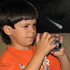 "08/15/09 - Determination - When you absolutely positively have to take the best picture ever...<br /> <br /> Johnny and I set up a scene of his Cars cars after work yesterday.  I took pictures.  He took pictures.  Here's a picture of him in front of the layout:<br />  <a href=""http://fotomom.smugmug.com/gallery/9249391_iqbi6#620287720_hokhA"">http://fotomom.smugmug.com/gallery/9249391_iqbi6#620287720_hokhA</a><br /> <br /> There's a mural on the wall behind Johnny, and that white spot is a comet:-(<br /> <br /> We're headed to the Museum of Life and Science in Durham today for Engineer's Day.  Lots more picture ops today!"