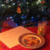 "12/25/09 - Santa Came!  Santa Came!<br /> Merry Christmas to all my friends out there in the SmugMug community!<br /> <br /> The kids and I baked chocolate chip cookies last night and set out a plate for Santa:-)  The kids had both brought home reindeer food from school:<br />  <a href=""http://www.smugmug.com/community/DailyPhotos/popular/today/1/748672035_ktbYn#748707324_6A3SY"">http://www.smugmug.com/community/DailyPhotos/popular/today/1/748672035_ktbYn#748707324_6A3SY</a><br /> and that was sprinkled on the front lawn.  <br /> Then Joey wrote this note, ""for Santa, P.S. I left some Reindeer food out side.""  Sweet!  <br /> The kids are not up yet but due any minute:-)  Purple Santa paper for Johnny and blue Santa paper for Joey. There's a bit more on the other side too.<br /> <br /> Dad was supposed to come yesterday, but he was not feeling well enough to travel.  That is a sadness for us, but nothing we can do but call and wish him the best over the phone later.  <br /> <br /> Thanks for all your support and encouragement this year!<br /> <br /> Here's hoping you are having a great holiday season with friends and family!<br /> Maryann"