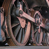 "08/29/10 - Big Wheels Keep on Turning<br /> You can't walk into the Roundhouse at Historic Spencer Shops at the NC Transportation Museum as a photographer and not notice the wheels on the trains.  They are  big!  These wheels belong to this engine:<br /> <br /> <a href=""http://fotomom.smugmug.com/Nature/NC-Transportation-Museum/13536357_4mrjs#986240439_N25MT"">http://fotomom.smugmug.com/Nature/NC-Transportation-Museum/13536357_4mrjs#986240439_N25MT</a><br /> <br /> and to put them into perspective, here's a picture of Joey next to them:<br /> <br /> <a href=""http://fotomom.smugmug.com/Nature/NC-Transportation-Museum/13536357_4mrjs#986258105_xceUF"">http://fotomom.smugmug.com/Nature/NC-Transportation-Museum/13536357_4mrjs#986258105_xceUF</a><br /> <br /> The 544 Seaboard Airline steam locomotive, the iconic engine that sits in the first stall of the Roundhouse, is one of the most unique pieces of rail equipment at the museum. The large Decapod (an engine with 10 driving wheels) was originally built for Russian railroads, but a civil war there kept the engine in the United States. Because Russian rails have a broader gauge than U.S. rails, the engine was fitted with especially wide wheels to accommodate U.S. track (text borrowed from another Blogger).  <br /> <br /> Some other interesting facts:<br /> 1. The Town of Spencer exists primarily because of Spencer Shops, and grew up around the repair facility–the complex opened in 1896 and at it's peak employed 3,000 people and was later converted to repair diesel locomotives. The repair facility closed in 1960. <br /> 2. The Back Shop, which is the length of two football fields, 150-feet wide and 1 ½ stories tall, was for many years the largest industrial building in North Carolina. The building was used to do complete rebuilds to Southern Railway's steam locomotives. During its heyday, one locomotive a day would be completed and sent back on its way, with about 10-15 engines being overhauled at any given time. This building is currently being renovated and will soon be open to the public.<br /> 3. The shops were named for Southern Railway's president, Samuel Spencer. Spencer served as a Confederate officer in the Civil War. Ironically, he was killed in train wreck in 1906. Another train rammed his private rail car on the mainline in northern Virginia. <br /> 4. There's a working 100-foot turntable by the Roundhouse and at one time there was a smaller turntable behind the oil house. <br /> 5. The current 37-stall Roundhouse is believed to be the largest remaining such structure in the United States. It replaced an earlier 15-stall roundhouse, which stood in the same footprint. Parts of the old roundhouse floor were found when the current building was restored and renovated in 1996. <br /> 6. The Atlantic Coast Line 501 diesel locomotive has the notoriety of being the highest mileage diesel passenger engine in the world, with more than six million miles. This colorful purple, silver and gold engine still operates.  <br /> (1-6 Text borrowed from another Blogger.)<br /> <br /> The museum also hosts a building dedicated to the history of the automobile and a building dedicated to the history of the airplane.  There is a Wright Brothers replica and there is a scale model of the facility showing how it operated back in the day.<br /> <br /> The museum offers the young and old a chance to ride a train for the first or 100th time.  They pull one of their working engines out from the roundhouse using the turntable and attach some of the Pullman coaches in the yard and offer rides most days.  The boys and I also did this.<br /> <br /> You can even go for a spin on the turntable:<br /> <br /> <a href=""http://www.youtube.com/watch?v=Z7cKs15CXX4"">http://www.youtube.com/watch?v=Z7cKs15CXX4</a><br /> <br /> Yesterday, they happened to have a classic fire truck show going on, and that was a huge hit with the boys too as they got to try on fireman hats, sit at the wheels of the big rigs, and even blow the horn:<br /> <br /> <a href=""http://www.youtube.com/watch?v=uOp-zCH1AnY"">http://www.youtube.com/watch?v=uOp-zCH1AnY</a><br /> <br /> I created a blog post that showcases the best pics of the day:<br /> <a href=""http://maryanng.blogspot.com/2010/08/nc-transporation-museum-visit.html"">http://maryanng.blogspot.com/2010/08/nc-transporation-museum-visit.html</a><br /> <br /> HAGD,<br /> Maryann"