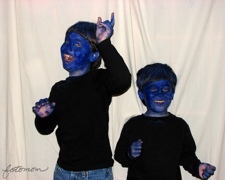 10/16/09 - The Next Generation Blue Man Group<br /> I had an idea, and my kids are good sports.  After a blue day and a green day this week, I was thinking today should be a red day.  But, instead you get this shot of blue little boys cutting up and having a hilariously funny time.   I have no skills in putting on make-up and no real flash equipment, so this surely not as good as it could be.  It's just my dining room with a sheet thrown up over the French doors coming in from the garage area.  Trying to get two kids to pose and stand reasonably still after basically giving them a license to cut up was, um, not easy:-)  I did try some non flash shots, but that was a no go due to them not being able to not squirm.  However, they had fun and were as cooperative as they could be.  And, most important, the blue came off easily in the tub!<br /> <br /> I'm trying some different stuff this week.  Thanks for hanging in there with me.  Hopefully the sun will be out soon and I can get back to some of my normal POTDs.<br /> <br /> HAGD,<br /> Maryann