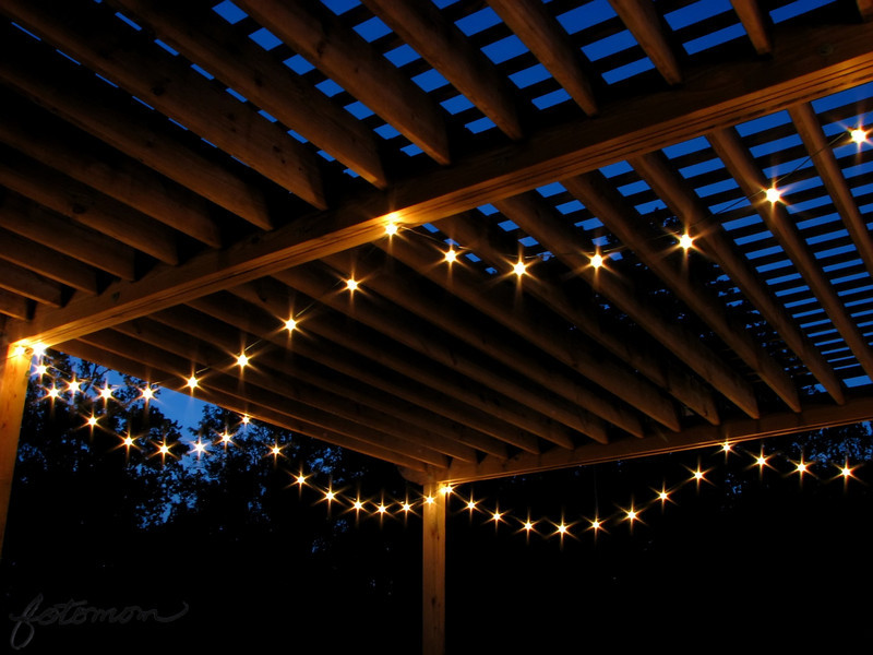"05/03/11 - Starlight Romance<br /> <br /> At night, the local farm stand, Porters, takes on a romantic feel when they turn on the lights on the pergola.  Beneath the lights are picnic tables, and families can eat their homemade ice cream under there or over on one of the seat swings nearby.  I'm totally hooked.  With a sandbox on just the other side of the pergola and fresh produce including strawberries this time of year, it's a great family outing.  <br /> <br /> Anyway, just something a bit different today.  BTW, the lemon pie flavor I had last night was super!<br /> <br /> Thanks for your comments on the yellow iris.  I took some of Danny's purple irises yesterday:<br /> <br /> <a href=""http://fotomom.smugmug.com/Nature/May-2011/16865229_xX2Jk5#1275146331_QSqV2Vv"">http://fotomom.smugmug.com/Nature/May-2011/16865229_xX2Jk5#1275146331_QSqV2Vv</a><br /> <br /> HAGD,<br /> Maryann"