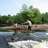 "06/20/11 - Teamwork<br /> <br /> As we were enjoying the view and cool water at Lanier Falls at Raven Rock State Park, another group of people showed up.  An older married couple and either their son and his girlfriend or their daughter and her boyfriend.  This is the younger couple walking across part of the falls to get to the big rock outcrop.  The only time of year it's probably safe to go across here is in the summer when the water level is down.  Still, there was a pretty good current flowing here.  I held onto Madi very tightly as we ventured across.  And after considering leaving my camera behind, I did take it with me to get shots like this:<br /> <br /> <a href=""http://fotomom.smugmug.com/RavenRockStatePark/Raven-Rock-061811/17632653_RQCSnH#1343969411_HbFq6Cv"">http://fotomom.smugmug.com/RavenRockStatePark/Raven-Rock-061811/17632653_RQCSnH#1343969411_HbFq6Cv</a><br /> <br /> I loved watching the chocolate lab cross in this canoe:<br /> <br /> <a href=""http://fotomom.smugmug.com/RavenRockStatePark/Raven-Rock-061811/17632653_RQCSnH#1343971796_T7dCqQL"">http://fotomom.smugmug.com/RavenRockStatePark/Raven-Rock-061811/17632653_RQCSnH#1343971796_T7dCqQL</a><br /> <br /> Here's their video crossing:<br /> <br /> <a href=""http://www.youtube.com/watch?v=xi_DOjPsb5A"">http://www.youtube.com/watch?v=xi_DOjPsb5A</a><br /> <br /> HAGD,<br /> Maryann"