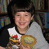"09/17/09 - Joey was a bit bummed that Johnny made my daily on Tuesday and he did not, so...  Although I didn't get the lighting and sharpness just right in this one, I decided to post it 'cause I sure did get the smile right.  I had both kids on the kitchen table last night posing with their 'loveys'.  Joey has had Lovey the Lion and Blankie since he was born, and even though he's going on 7 in October, he's still VERY fond of them.  They stay in his bed, but he has to have them to go to sleep. No small feat keeping up with these guys for 7 years I gotta tell ya!  <br /> <br /> You'll notice he has on his Mario PJs;-)  For those of you that gamed in a prior lifetime, Mario is alive and well with the next generation of kids too.  <br /> <br /> Johnny with all his cuteness is posing with his Star Teddy here:<br />  <a href=""http://fotomom.smugmug.com/Children/Joey-Johnny-Friends/8602366_itiXh#651926139_32cN4"">http://fotomom.smugmug.com/Children/Joey-Johnny-Friends/8602366_itiXh#651926139_32cN4</a><br /> He's got on Scooby PJs:-)<br /> <br /> The darn central NC forecast looks like rain and clouds for a week:-(  Looks like more glass shots on the way!<br /> <br /> Thank you for sharing my excitement and enthusiasm over the GBH shot:-)<br /> <br /> HAGD,<br /> Maryann"