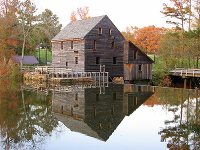11/05/09 - Historic Yates Mill Pond at Sunset I posted a picture of the actual water wheel in my gallery earlier this year.  In this picture, you can't see the wheel, but you get this lovely reflection instead.  After Joey's flu shot, I decided to make the best of a wonderful afternoon and go for a quick hike around the mill pond.  Unfortunately, we were really there a good 30-60 minutes too late to be taking good pictures.  I had to bump up the saturation on this one to improve the color.    This is the same shot taken on 10/26 last year when the sun was better and the tree closest to the mill still had yellow leaves on it.  http://fotomom.smugmug.com/Yates-Mill-Pond/Yates-Mill-Photo-Contest-2009/7088136_34LZC#454338880_TdGL2 In both cases, the sky looks better in the reflection than in the final shot.  I'm not sure how to get around that...especially in last night's picture when the sky really didn't have much blue in it.    We still have not had a frost or freeze at my house, but it look like it's coming Friday night into Saturday.  I am storing ceramic bird baths and pots and taking in fragile plants that I can save.    I sure wish today was Friday... HAGD, Maryann