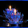 "02/05/11 - Blue Glow<br /> <br /> Joey really, really wanted to shoot candle pictures last night.  He was a little upset that I did The Candle Machine shoot without him the other night.  I simply explained that when I take pictures after 10PM that it's too late for him to assist.  At any point, I replaced my broken mirror at WM on Thursday, and I got out the black foam board and several mirrors, and he, Johnny, and I set to work.  We tried various things including non candle stuff.  A link to a shot Joey set-up and took is below.  <br /> <br /> After the kids were in bed, I washed and started taking pics of this.  Joey snuck back out to help:-)  You should have heard how excited he was by the beauty of this piece and the set-up in the dark.  The room glowed so nicely.  <br /> <br /> I have a new mirror box that I am kindof excited about which this was taken in:<br /> <br /> <a href=""http://fotomom.smugmug.com/Nature/February-2011/15678719_FPSPQ#1177829528_ccMh9"">http://fotomom.smugmug.com/Nature/February-2011/15678719_FPSPQ#1177829528_ccMh9</a><br /> <br /> The left and front and top are removable.  So, 3 fixed sides and 3 I can remove or  angle.  It's fun stuff!  Would work better I think if were a rectangle.  The short sided square makes getting the angle on infinity a bit trickier than I'd like.  For now this was inexpensive and  fine.  Some of you have light boxes.  I have a mirror box:-)<br /> <br /> I cropped to 8X10 and removed some small spots otherwise sooc and an OnOne PhotoFrame added.  In this case, my LED color changing light is under the candle.  Joey said it would look best with the LED AND the candle flame, and he was right.  There is wrapping paper (on cardboard) with sparkles also under the candle.  I used it weeks ago with one of my snowman shots.  It bounces the light very nicely.  A small hole in the cardboard/paper lets the LED light through but hides the 1"" tall small square base of it.<br /> <br /> See Joey's POTD here<br /> <br /> <a href=""http://fotomom.smugmug.com/Daily-Photos/LightningFastJoeys-POTD/11187845_dd7pS#1178033599_Eybrt"">http://fotomom.smugmug.com/Daily-Photos/LightningFastJoeys-POTD/11187845_dd7pS#1178033599_Eybrt</a><br /> It's hair raising:-)<br /> <br /> Thanks for all the comments on yesterday's bird shot and als the extra ones in the gallery for the SP and the cardinal shots.  You guys are the best!<br /> <br /> HAGD,<br /> Maryann"
