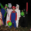 "11/1/09 - Trick-Or-Treat!<br /> Here are the kids that made my Halloween so special this year.  From left to right is Sophie, Sienna, Joey, Grayson, Johnny, Madi, Eli, and Celeste.  Sienna's baby sister Mira is not pictured, but otherwise, this is 5 households of kids.  A great bunch, and they had a great time as did us parents walking with them.  75 degrees at dark.  We were SO hot!  <br /> <br /> If you'd like to see a picture of the haunted garage, go here:<br /> <br /> <a href=""http://fotomom.smugmug.com/Children/Halloween-Fun-2009/9845761_KK5Lt#699269432_Fnfhj"">http://fotomom.smugmug.com/Children/Halloween-Fun-2009/9845761_KK5Lt#699269432_Fnfhj</a><br /> It was a big hit with all the kids...spooky but not too spooky;-)<br /> <br /> Rain here...AGAIN.  So much for a hike in the woods today:-(  Too wet to put up the outdoor decorations too.  Beats a work day though!!!<br /> <br /> HAGD,<br /> Maryann"