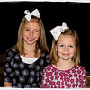 "03/05/11 - White Bows<br /> <br /> Madi is on the left and Eliza is on the right.  The kids' elementary school had their annual PTA Spring Festival fundraiser last night.  Hots dogs, carnival games, and basket raffles.  Madi came with me and the boys, and I smiled when I saw her in the white bow.  It matched her outfit perfectly.  I knew there would be a chance that Eliza would show up with a bow too, so I kept an eye out.  Whatta ya know...white bow too!  So Madii and I made sure to look out for her in the crowd so we could get a picture.  Aren't they cute?!?  Eliza is in Joey's class.  Madi is a year behind them.  Yes, she is a VERY tall girl.  <br /> <br /> To top off our evening, Madi won one of the baskets...a $200 gift card to Wal-Mart!!  Woo hoo!  A collage showing writing the tickets out, happened to take one of her reaching for THAT basket, one with the asst. principle and principle holding the winning card, and one of her with the card and a smile is here:<br /> <br /> <a href=""http://fotomom.smugmug.com/Nature/March-2011/16046070_gZarf#1206042191_YMSvT"">http://fotomom.smugmug.com/Nature/March-2011/16046070_gZarf#1206042191_YMSvT</a><br /> The videos next to the collage are kindof cute too...freeze dance.<br /> <br /> I got rid of the background directly behind the girls in this shot, ran a portrait filter on it, tried to tone down the face shine, cropped to 8X10, and added the frame to emphasize the white:-)<br /> <br /> Thanks for your comments on the daffodil shots.  I didn't get to take any more flower pics yesterday:-(  Boy was it a hectic day!<br /> <br /> HAGD,<br /> Maryann"