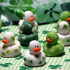 """02/12/10 - The Duck of the Irish<br /> I have to work a split shift today AM and then 5-8.  But this afternoon I will be in full party set-up mode for our Shamrock Party tomorrow.  I can't wait!  I ordered these cute smaller than typical rubber ducks from Oriental Trading Company as one of the party favors.  Aren't they cute?!?  The background fabric is a scarf that we'll use as part of the 'dancing' activity.  Dance to the kids usually means run like crazy in a circle around the craft table:-)  The fabric under the ducks is just a large piece of fabric I bought several years back.   When the kids were smaller, we played ghost with it.  As in we'd throw it over the kids to hide them and then they'd spring back to life and knock it off.  Unfortunately, although they still want to play ghost, they just can't fit under it anymore.  Lots of memories from the past and soon to be made in this shot.<br /> <br /> I took some wet flower pictures outside with Johnny yesterday, but we're in this weather cycle where it's cloudy and raining on and off for like a week:-(  I just didn't like the dark shots.  Bring back my sun, please.  <br /> <br /> Johnny has a cute sad sack puppy dog statue picture for you today here:<br /> <a href=""""http://fotomom.smugmug.com/Daily-Photos/LightningFastJoeys-POTD/11187845_dd7pS#808335310_GqKD7"""">http://fotomom.smugmug.com/Daily-Photos/LightningFastJoeys-POTD/11187845_dd7pS#808335310_GqKD7</a><br /> <br /> Thanks for the feedback on the oddly dark colored helleborus.  I noticed this morning that the flowers are starting to fade away, so it's a good thing I got in my shot while I could.<br /> <br /> HAGD,<br /> Maryann"""