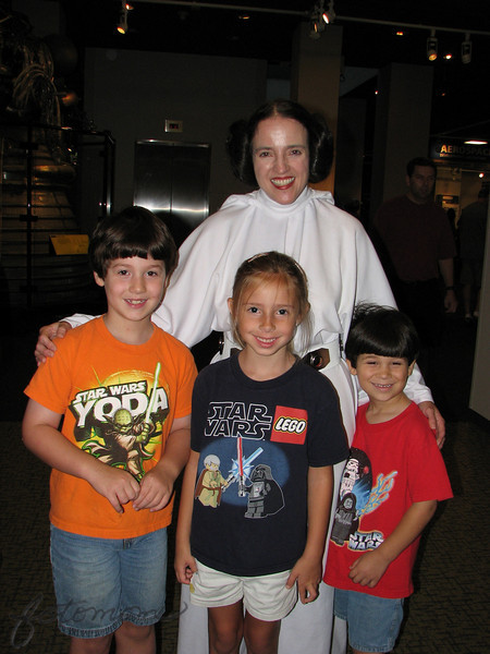 09/13/09 - If I tell you that we had a great time at the Heroes and Villians event at the Museum of Life and Science in Durham yesterday I know you'll believe me;-)  Just in case you aren't a huge Star Wars fan, this is Princess Leia posing with Joey, Madi, and Johnny (Left to right).  Neat staircase effect as Joey is 7, Madi 6, and Johnny 5 (well nearly).  Joey was here with me this morning and we flipped to post the shot of them with Darth or Leia.  Leia won.  <br /> <br /> I probably took the best Great Blue Heron AND Green Heron shots that I've ever taken in the museum wetlands area yesterday.  But, yesterday was about the kids, and herons can wait until tomorrow.  <br /> <br /> Glad you guys liked the pink morning glory.  Thanks for visiting my daily and giving me feedback.<br />  <br /> After 7 hours at the museum plus 2 hours on the road and everything else yesterday I could use a little rest today.  Instead, I'm sure we'll be as busy as usual.  I was working so hard on my blog post of the event last night, but I fell asleep sitting up with my laptop in my lap twice on the loveseat.  Finally I finished and went to bed.  <br /> <br /> HAGD,<br /> Maryann
