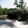 "07/19/11 - Pano of Lanier Falls at Raven Rock State Park<br /> <br /> This one is for Art...been a long time coming me posting a pano.  <br /> <br /> Happy Father's Day!<br /> <br /> Christine, Madi, and I made the trek over to Raven Rock State Park in Lillington yesterday.  We did not go to 'the rock'.  Instead, we took the Campbell Creek Loop trail over to Lanier Falls.  It's about a 6 mile hike with the falls being at the halfway point.  We left early, so the hike to the falls wasn't too bad.  There's  nice mix of flat, uphill, and downhill on the path.  We saw mushrooms, ferns, and lots of neat-shaped trees in the woods.  Coming up to the falls was a refreshing site.  The water is down this time of year, so we were able to cross over to the big rocks out in the middle of the Cape Fear River and walk around and get our feet wet.  We got to see about 10 canoes come up to the rocks and figure out how to pass over.  One canoe tried to pass at the wrong spot IMO and tipped.  Some of the other boaters came over to help.  Of course I took my fair share of pics including a bunch of damselflies. We ate our snack and started back on the loop trail continuing in the direction we had been headed (we did not double back on the loop).  The last 1/2 mile is all up hill, and at that point, we were tired and it was in the mid 90s.  Ugh.  Well worth the walk, though, to go to that great water spot in warm weather.  We hope to canoe it ourselves soon or at least have bathing suits and life vests so we can venture in the water a bit more. AC and drinks were a welcome treat once we were back in the car.  <br /> <br /> I featured a new gallery of all the shots taken at Raven Rock yesterday here:<br /> <br /> <a href=""http://fotomom.smugmug.com/RavenRockStatePark/Raven-Rock-061811/17632653_RQCSnH#1343966112_t6GTDL2"">http://fotomom.smugmug.com/RavenRockStatePark/Raven-Rock-061811/17632653_RQCSnH#1343966112_t6GTDL2</a><br /> <br /> It was fun shooting Christine and Madi as mom and daughter, and I created a collage of the best of those pics too:<br /> <br /> <a href=""http://fotomom.smugmug.com/Daily-Photos/My-Best-Daily-Shots/8520201_U76qq/1338480084_zMTHGMk#1343996164_hxDSZ2B"">http://fotomom.smugmug.com/Daily-Photos/My-Best-Daily-Shots/8520201_U76qq/1338480084_zMTHGMk#1343996164_hxDSZ2B</a><br /> <br /> HAGD,<br /> Maryann"