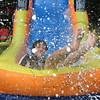 "06/01/10 - Slide!<br /> We received an invite to come back for Day #2 on the waterslide.  Once you have the slide set-up and the canopy and chairs plus have a lot of leftover food from Day #1, you might as well have some more fun, right?!?  It was a much smaller crowd on Day #2, and the kids and I played in the pool and on the slide for 6 hours.  Water volleyball and frisbee, the waterslide with various tubes, water balloons, hamburgers and cupcakes and popsicles...a really fun time!  <br /> <br /> This is Joey making a very huge splash on his way down.  The water jets up top continually soak the slide, and then the water collects at the bottom for the splash.  The water looks a bit white, and that's soap bubbles created by putting some dish detergent (Dawn) on the slide to speed 'er up!  I really love hanging out at the bottom of the slide with my camera trying to capture the moments as they happen.  Sometimes if I stop taking pictures I get called back, ""MeMe, come watch my super duper slide!""  ""Mom, this is gonna be the  biggest splash ever!""  I'm going to miss the weekend and the kids today for sure...<br /> <br /> I did take a few dragonfly pics yesterday.  They started landing on the wet floats around the pool.  I just thought a fun, festive and colorful shot was the way to go for a virtual Monday and wet Tuesday here.  Thanks for all your comments on yesterday's dragonfly shot.<br /> <br /> HAGD,<br /> Maryann"