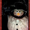 "12/02/09 - Let it Snow<br /> Well, I know some of you have had enough snow already, but I'll be lucky if I see a few flakes just south and east of Raleigh, NC so this is definitely a wish of mine especially with two little boys and an unused sled just rearing to go.<br /> <br /> I spent a lot of time on this one...much more time than the nutcracker, and it just didn't turn out how I'd hoped.  Mostly the lack of definition in the shovel around the words bothers me I guess.  At any point, it is what it is.<br /> <br /> Here's a version with the complete duo of fiber optic snowmen:<br /> <a href=""http://fotomom.smugmug.com/Nature/December-2009/10503706_iqUUs#729847002_CqxvL"">http://fotomom.smugmug.com/Nature/December-2009/10503706_iqUUs#729847002_CqxvL</a><br /> The guy on the right always glows darker/blue, and I wasn't sure I liked that so shot him out of the one I used for the daily.  If you go to the link you can see a set-up shot although it is not interesting today I don't think.  I did have some lights under the snowmen, but I don't think they helped or hurt.  Black foamboard and a flashlight again to help make the words show up better.  <br /> <br /> The more interesting part of this picture to me is the background.  I took that picture last December at a mall.  They were projecting snowflakes onto the ceiling with some sort of fancy flashlight.  I took a picture of that, but it was almost white.  However, using Picasa, I tinted it and WOW.  I can make it cany color I like:-)  What I did in this case was take 4 copies of the same tinted picture and then use the Picasa collage feature to turn them into one picture.  I did some rotating and mirroring of the various copies before kicking of the collage.  That gave me more flakes along the border which I wanted.  Just a slight bit of seem blending after the collage was built.  Anyway...playing with Picasa and PSE is fun if not maddening sometimes.<br /> <br /> Thank you for your comments on the nutcracker:-)<br /> <br /> Still coughing over here.  Will it ever really go away?!?<br /> <br /> Late note:  Because the shovel was driving me nuts, and thanks to Art's inspiration:<br /> <br /> <a href=""http://fotomom.smugmug.com/Nature/December-2009/10503706_iqUUs#730027995_KjSDh"">http://fotomom.smugmug.com/Nature/December-2009/10503706_iqUUs#730027995_KjSDh</a><br /> I didn't change the color, but I did try again to isolate the shovel (not easy) and then fool with the edges.  <br /> <br /> HAGD,<br /> Maryann"
